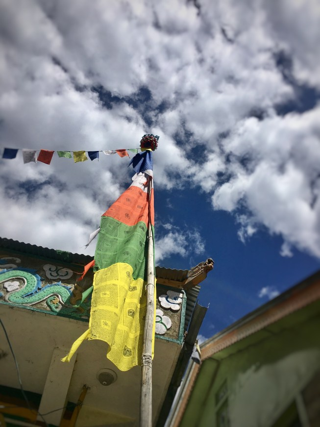 flags on a temple on  way to Kamru Fort Sangla valley, India