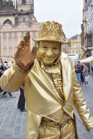 Artists covered in gold in Prague town square