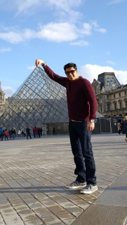 "Had to do the classic ""Taj Mahal"" pose at the Lourve that houses the famous painting of Mona Lisa"