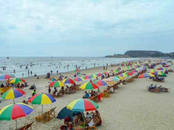 Montanita Beach very busy with umbrellas | Ecuador Itinerary