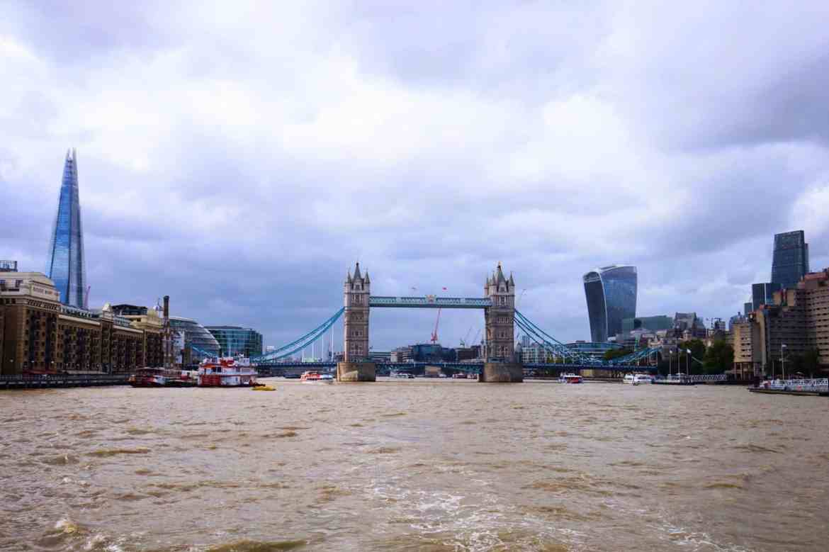 Cloudy and Rainy Skies on River Thames in London with Tower Bridge and Shard showing