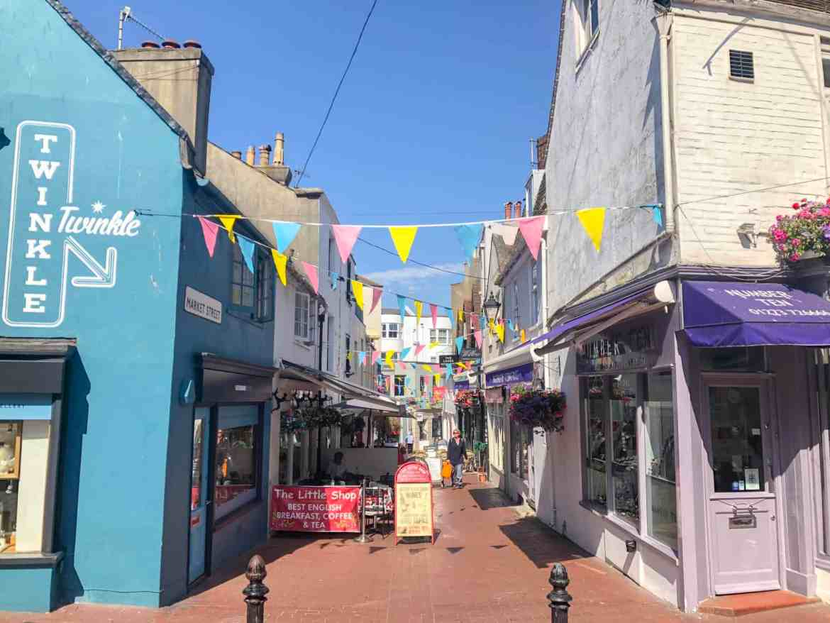 Brighton lanes colourful buildings blue sky | Brighton day trip from London by train