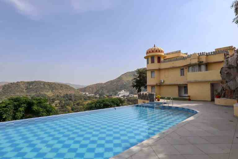 swimming pool and mountains at Shahpura Kumbhal   best places to visit in India