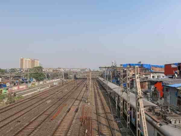 Dharavi Slum Tour Mumbai train tracks