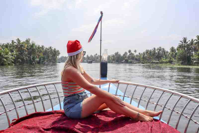 ellie quinn on boat in kerala in denim shorts and top