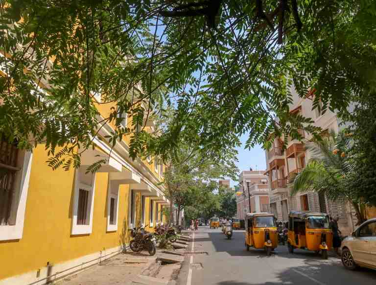 best places to visit in India, yellow building and green streets of pondicherry