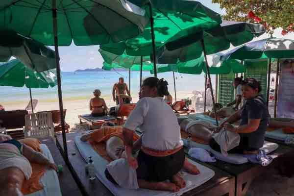 visiting koh samui on a budget massage on beach