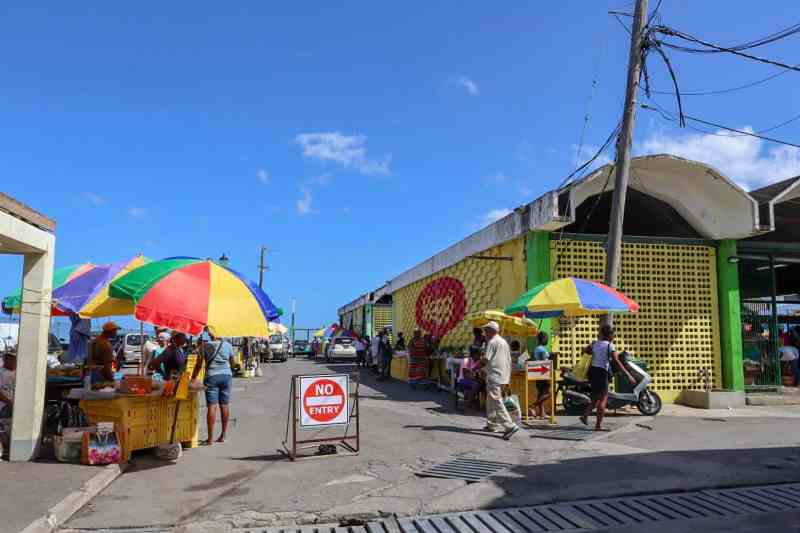 Roseau Dominica Saturday Market Colourful stands and fresh fruit and vegetables | unique things to do in Dominica