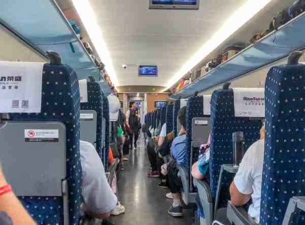 train travel in china, inside of a bullet train in china