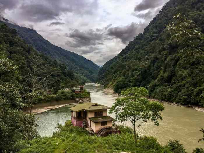 sikkim mountains and river in monsoon | best places to travel in Asia in July and August