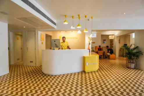 Yellow Reception at Bloom Rooms Hotel Janpath
