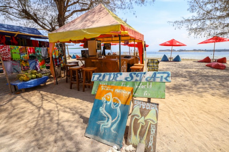 Magic Mushrooms sign on beach road   things to do in Gili T