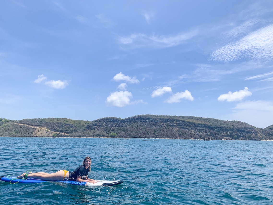 Bali Lombok itinerary, ellie quinn surfing in the middle of the ocean in Gerupuk