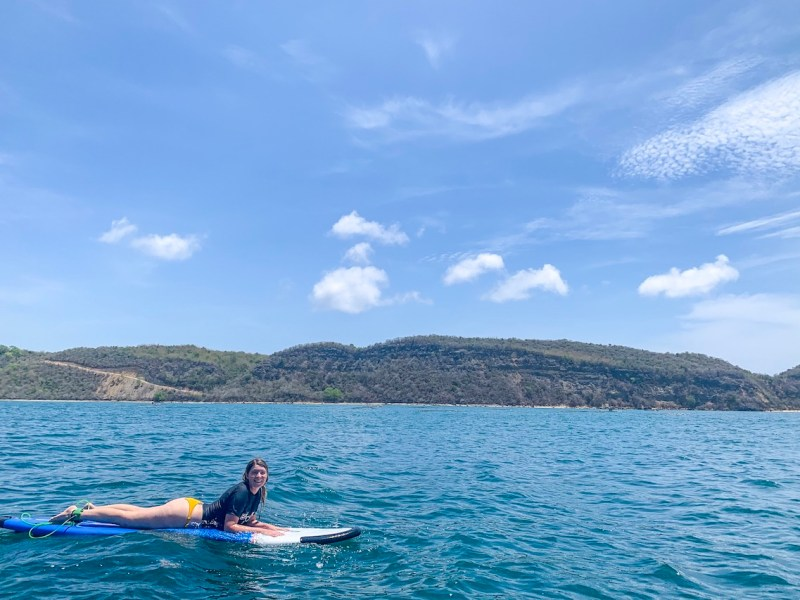 ellie quinn surfing in the middle of the ocean in Gerupuk | lombok itinerary