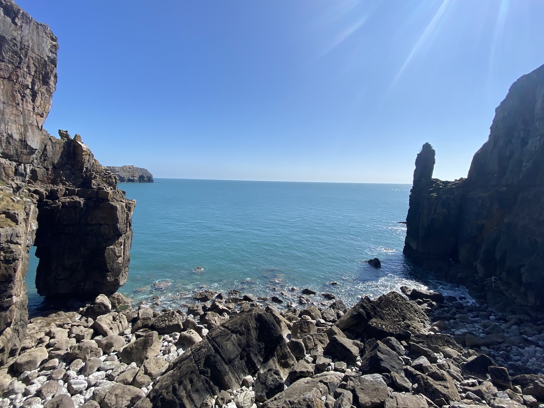 St Govan's Chapel at the ocean
