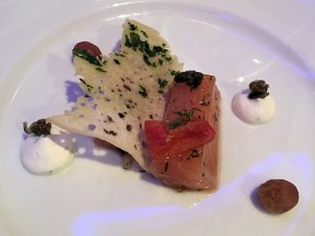 Cured Salmon, with candied tomato and grapes, dill cream, and capers.
