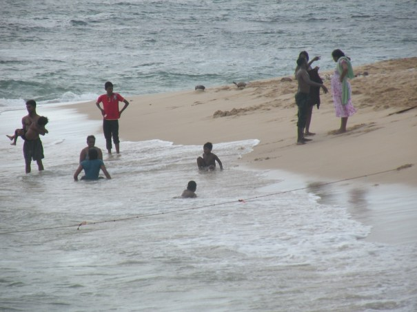 Playing on the beach, Unawatuna spit