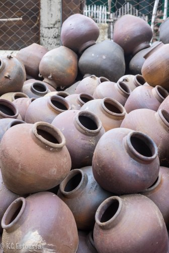 """burnay jars are laid out into the heat of the sun after """"baking"""""""