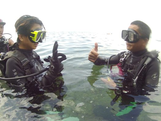 Dive Instructor Masoi teaching me the hand signals