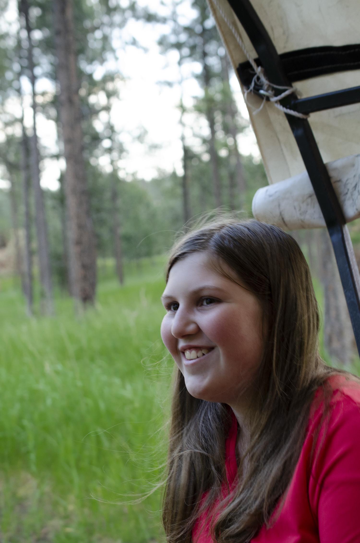 Emilie enjoying the wagon ride to