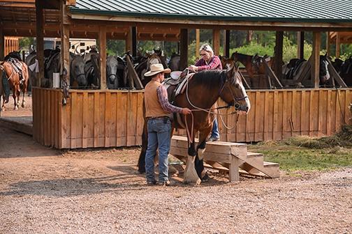 Christina climbing horse Palmer Gulch Stables