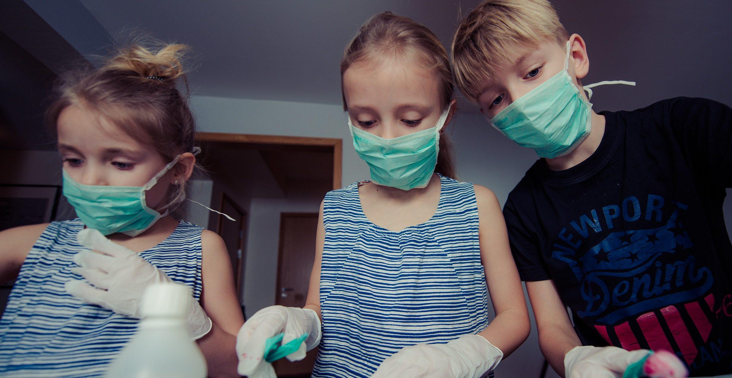 three-children-wearing-face-masks-695963