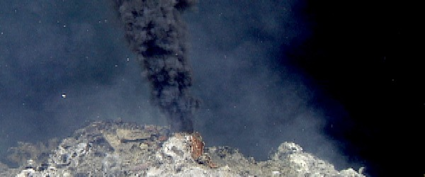 "Scientists have uncovered clusters of volcanic vents towering above the seafloor in a region of deep-sea off the coast of Mexico. The so-called ""black smoker"" vents lie about 7,400 meters (7,900 feet) deep with chimneys reaching 23 meters (75 feet). These magma-powered hydrothermal vents are essentially fissures and cracks in the ocean floor that allow seawater to reach deep, superheated rocks, producing scalding jets of chemical-laden water. Researchers from Monterey Bay Research Institute (MBARI) discovered these vent fields in late April, at..."