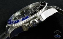 Review of the Rolex GMT Master II [116710BLNR] aka 'The Batman' Side view crown up low key photo