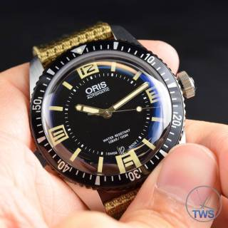 Oris held in hand - Oris Divers Sixty-Five: Hands-On Review [01 733 7707 4064-07 5 20 22]