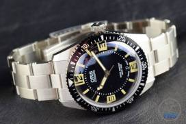 The Oris Divers Sixty-Five (With Metal Bracelet) [01 733 7707 4064-07 8 20 18] Laying on side on black background.