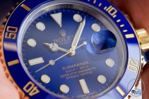 Hand held Rolex Submariner Date [116613LB] review with face catching the light