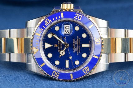 Submariner laying on side with crown facing up - Rolex Submariner Date: Hands-On Review [116613LB]