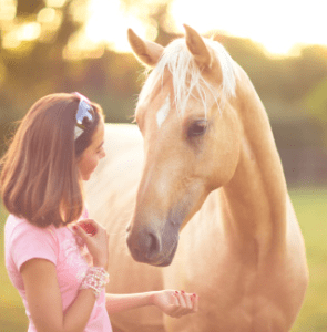 young girl with palomino