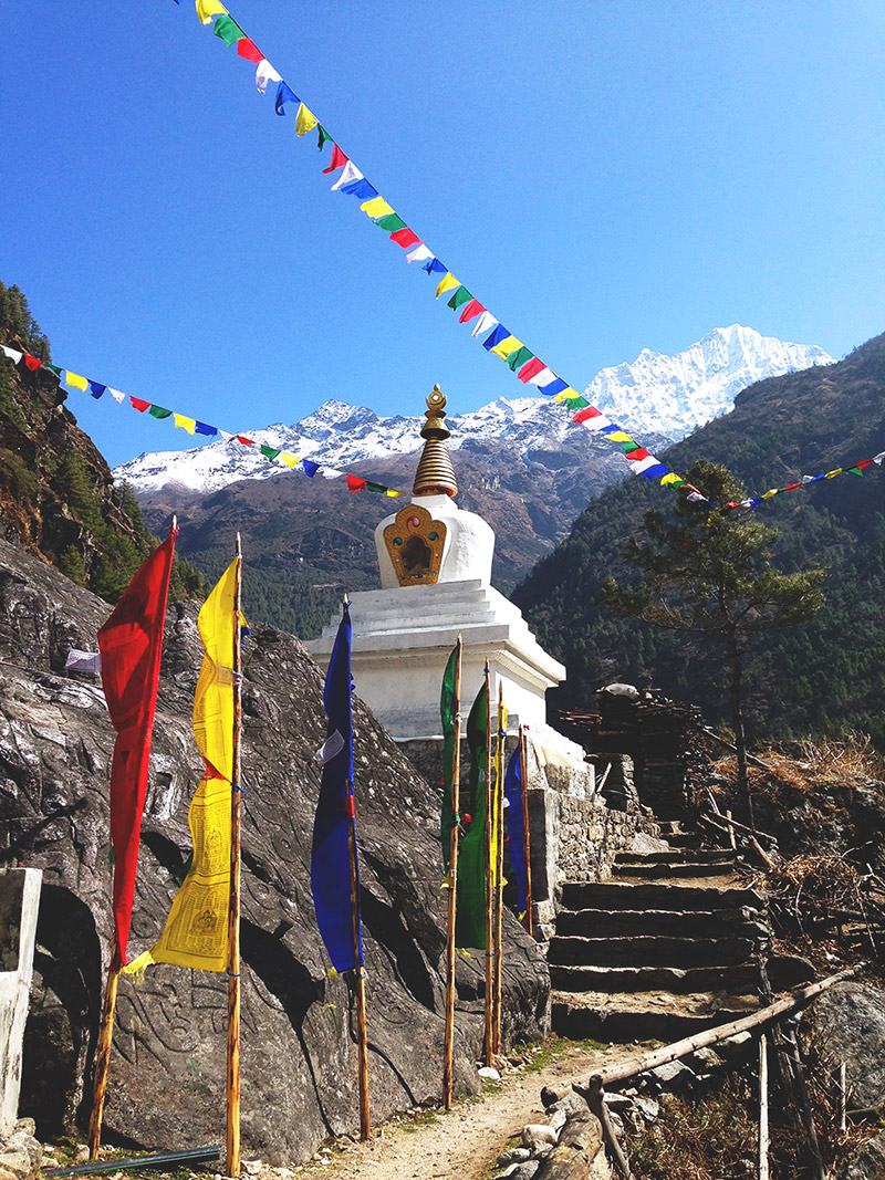 prayer flags colours rainbow stupa mountains landscape sky EBC trek nepal