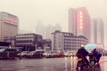 Rainy weather near the train station in Nanning, China. February 2014.