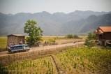 A songtau - large tuk-tuk truck - brings passengers into Kong Lo village. Laos, April 2014.