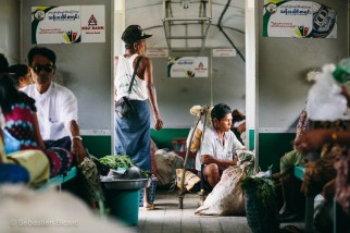 Yangon's suburban Circular Train transports locals along with the produce and wares they hope to sell in the city. Myanmar, May 2014.