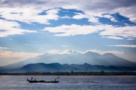 Mount Rinjani peeks through the clouds on Lombok as we enjoy our breakfast on Gili Meno. Indonesia, June 2014.