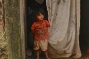 Child in Mayan village near Tulum.