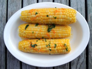 Vegetables, corn on the cob, boiled, with orange butter 1
