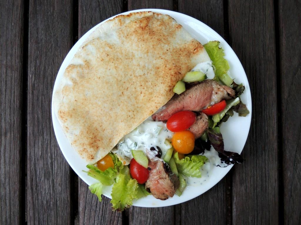 Sandwiches, lamb souvlaki sandwiches with Greek salad and tzatziki 1