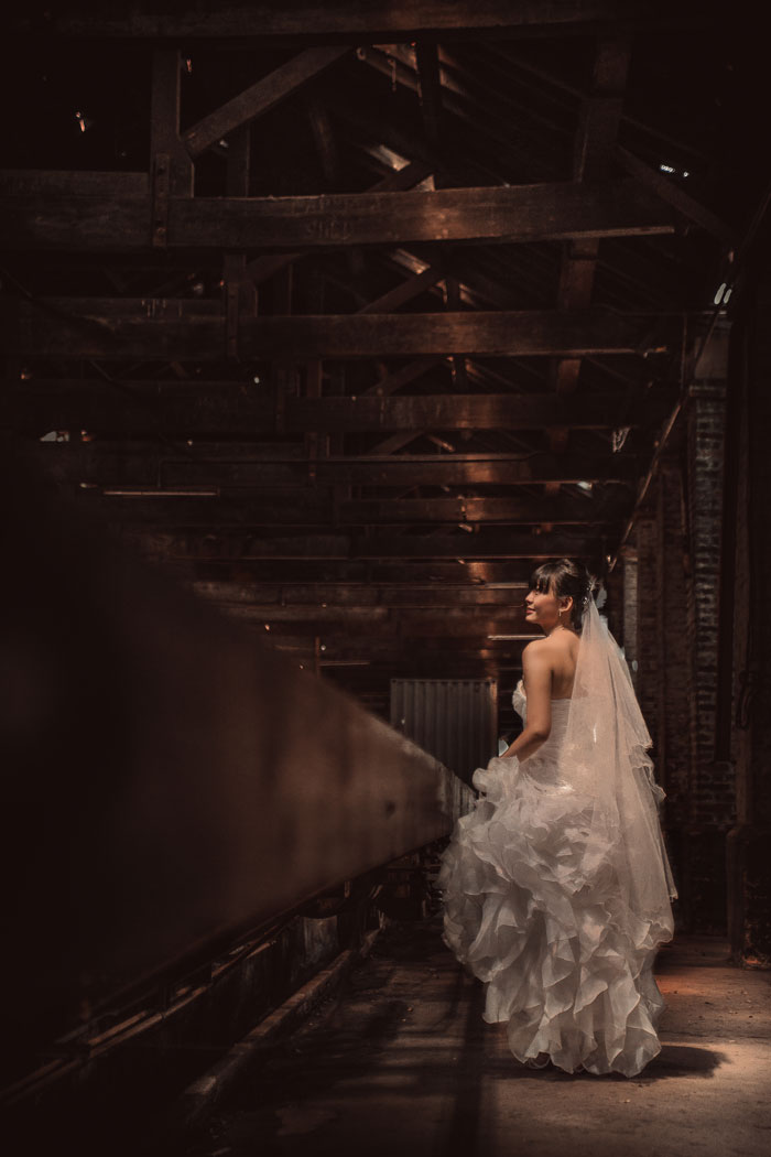 Ruffle bridal gown. Photography by Kennfoo Weddings