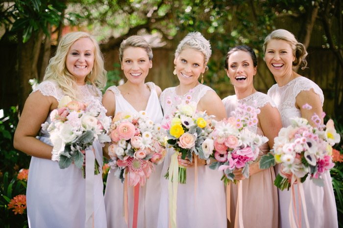 Bridesmaids in peach tones. Tealily Photography. www.theweddingnotebook.com