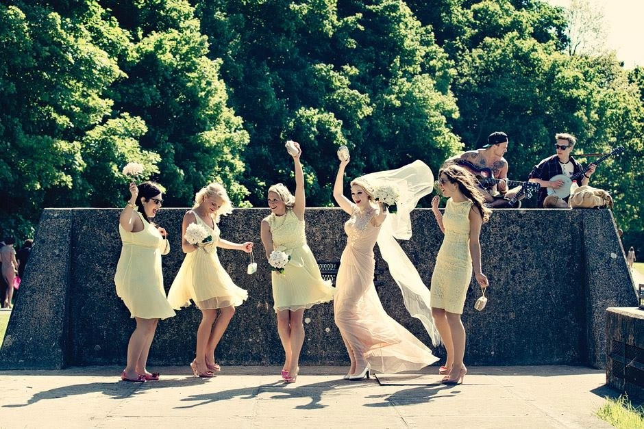 Dancing bride and bridesmaids - bride wears Champagne wedding dress and long veil
