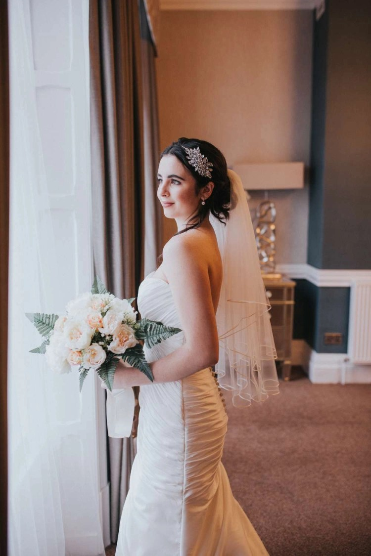 Amber - two tier waist length veil with a ribbon edge on model bride