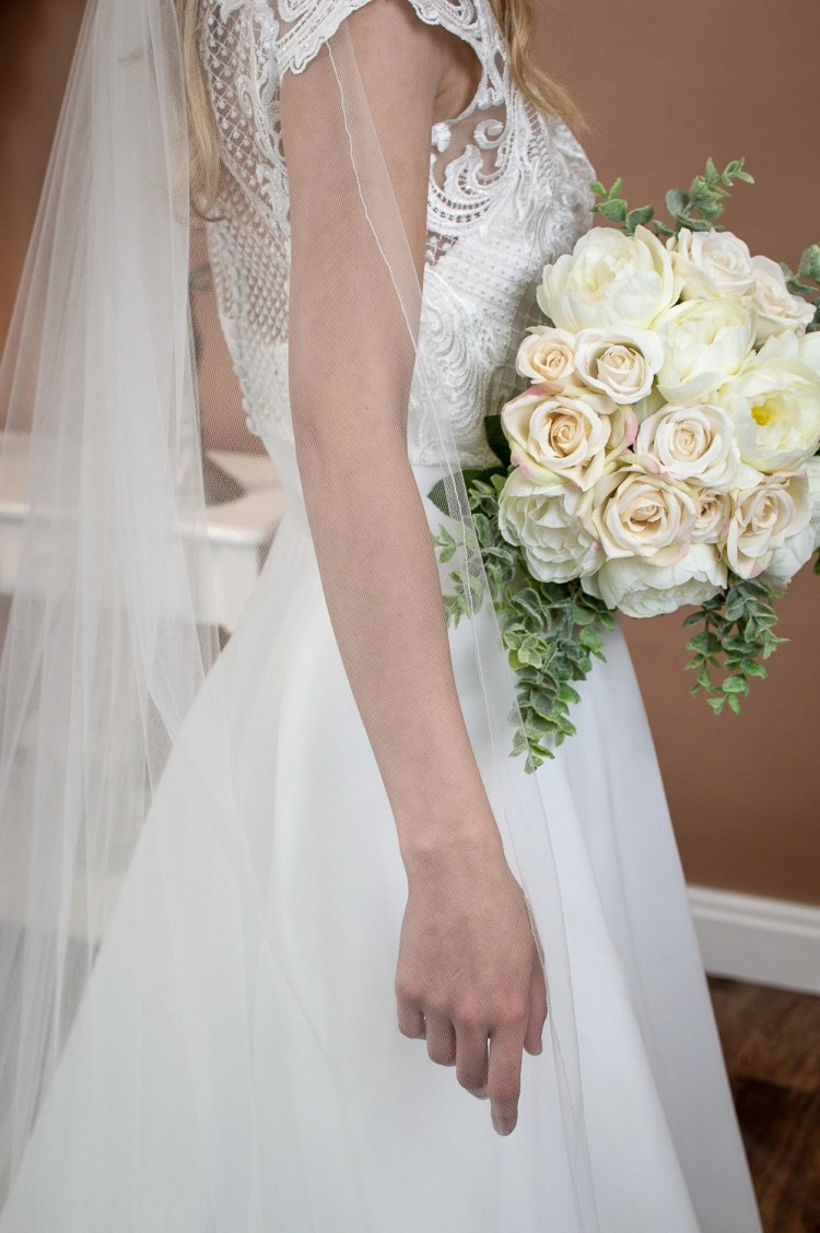 Brooke - single layer chapel length extra wide plain veil on bride closeup