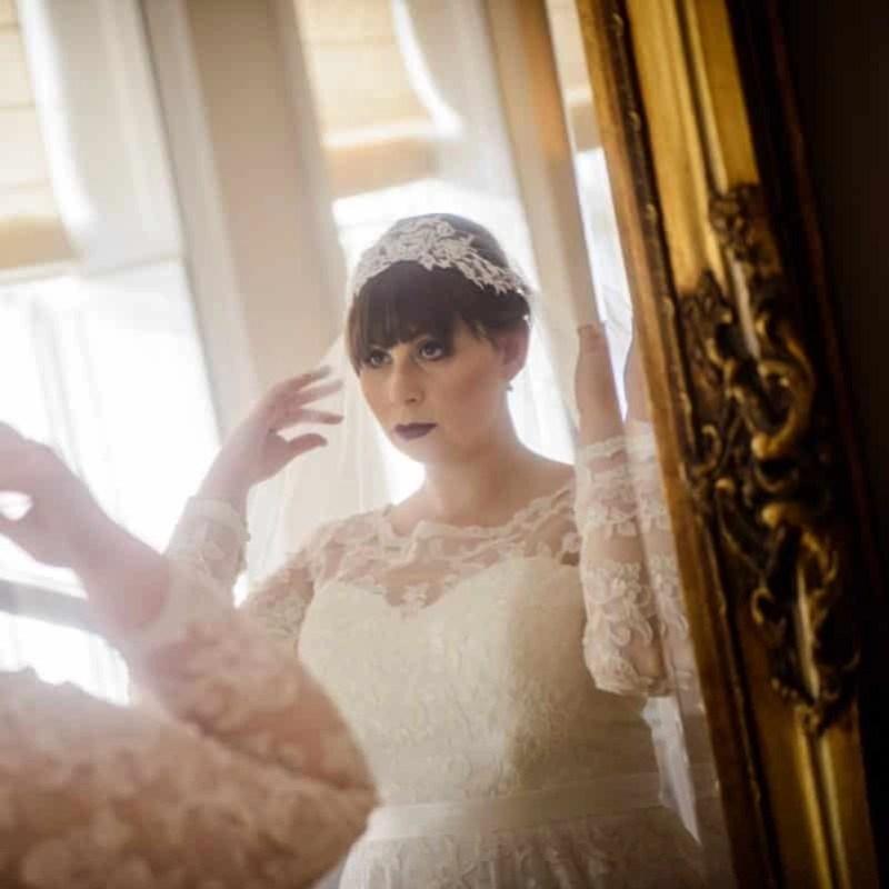Lace top Juliet cap veil on bride