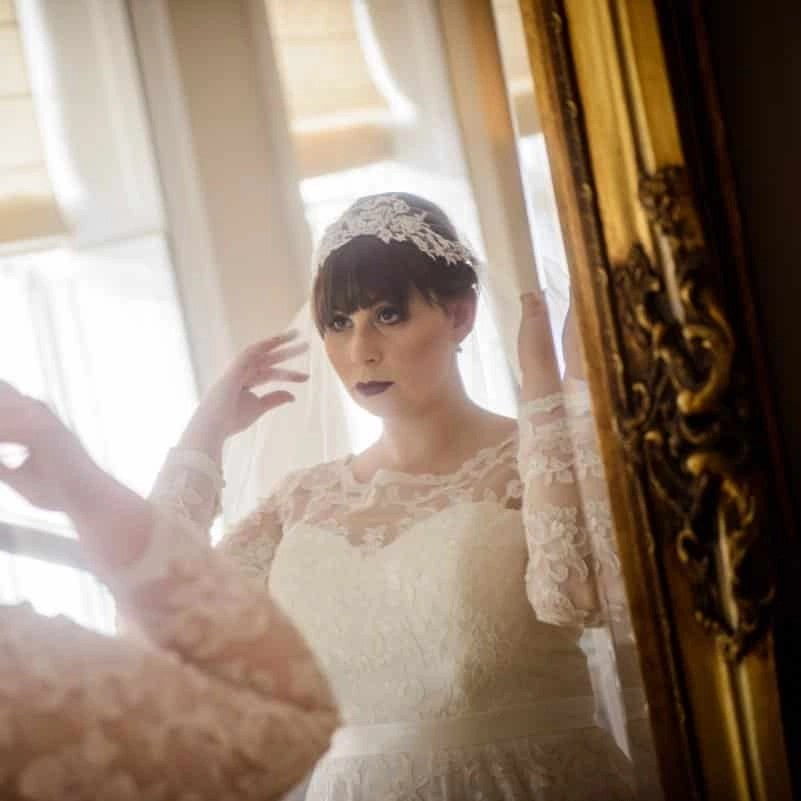 Lace top Juliet cap veil on bride