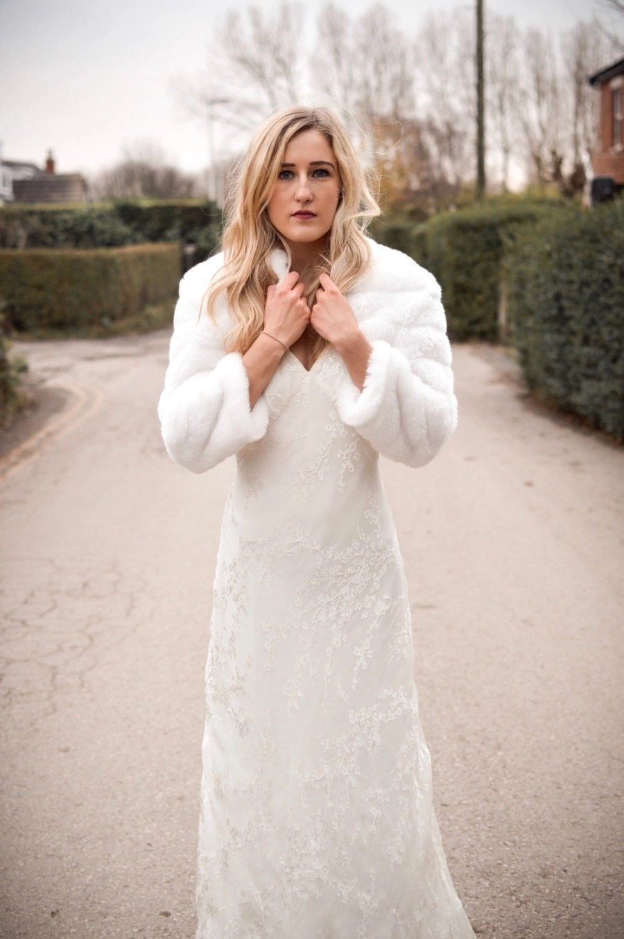 Faux fur cropped bridal jacket with sleeves on blonde bride - bb42