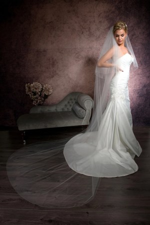 Pretty bride wearing a two layer cathedral length veil